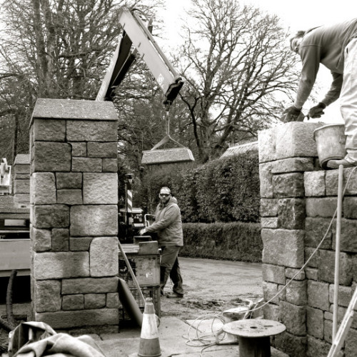 Arts and crafts manor, trestoring the gateway.