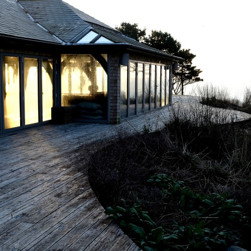 Green Oak poolhouse, with oak decking and natural meadow planting